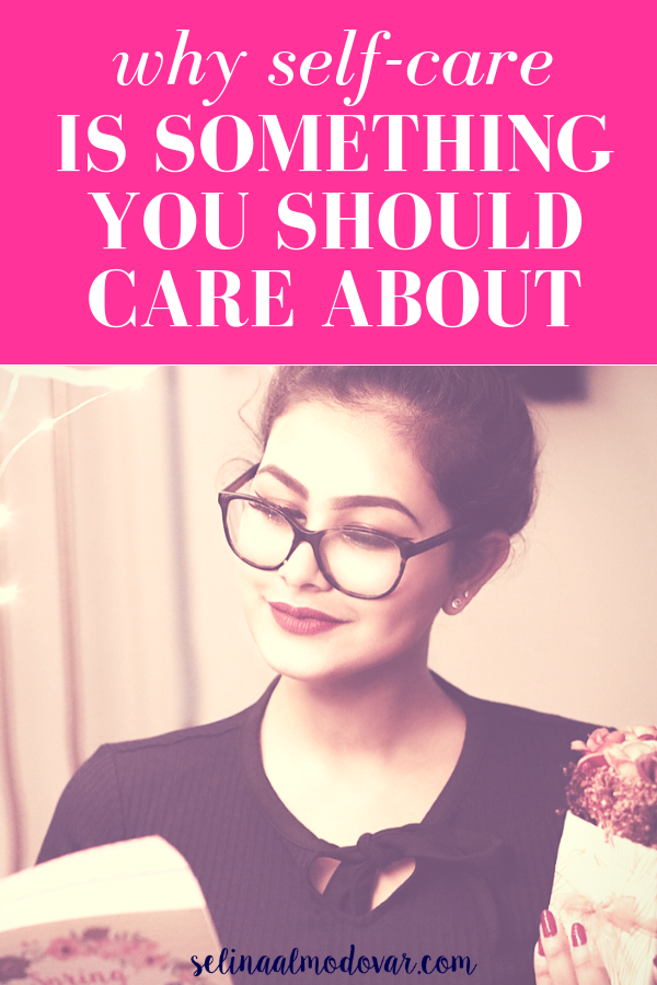 """girl with glasses smiles as she reads a book while holding a gift of flowers with pink overlay and white text that reads, """"Why Self-Care Is Something You Should Care About"""""""