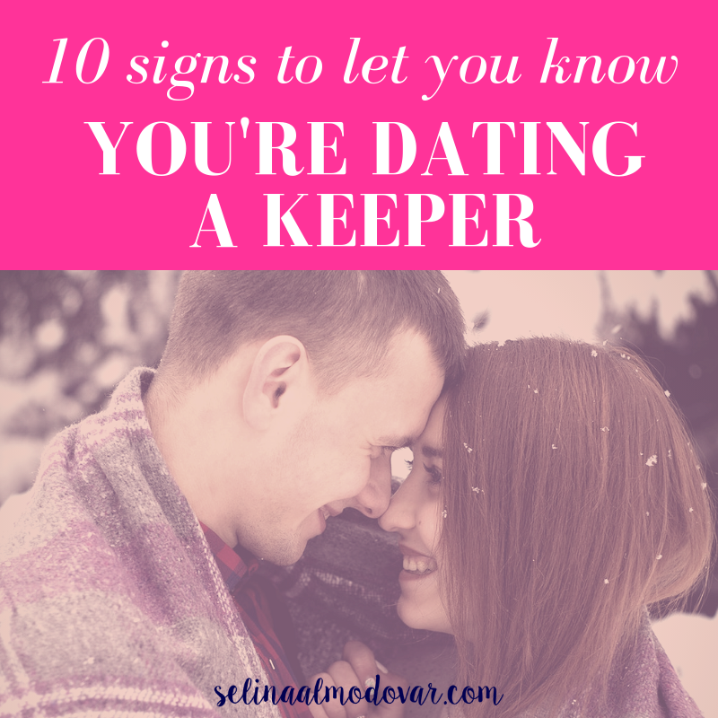 "girl and guy stare at each other and smile as they share a winter blanket outside in snowy weather with pink overlay and white text that reads, ""10 Signs to Let You Know You're Dating a Keeper"""
