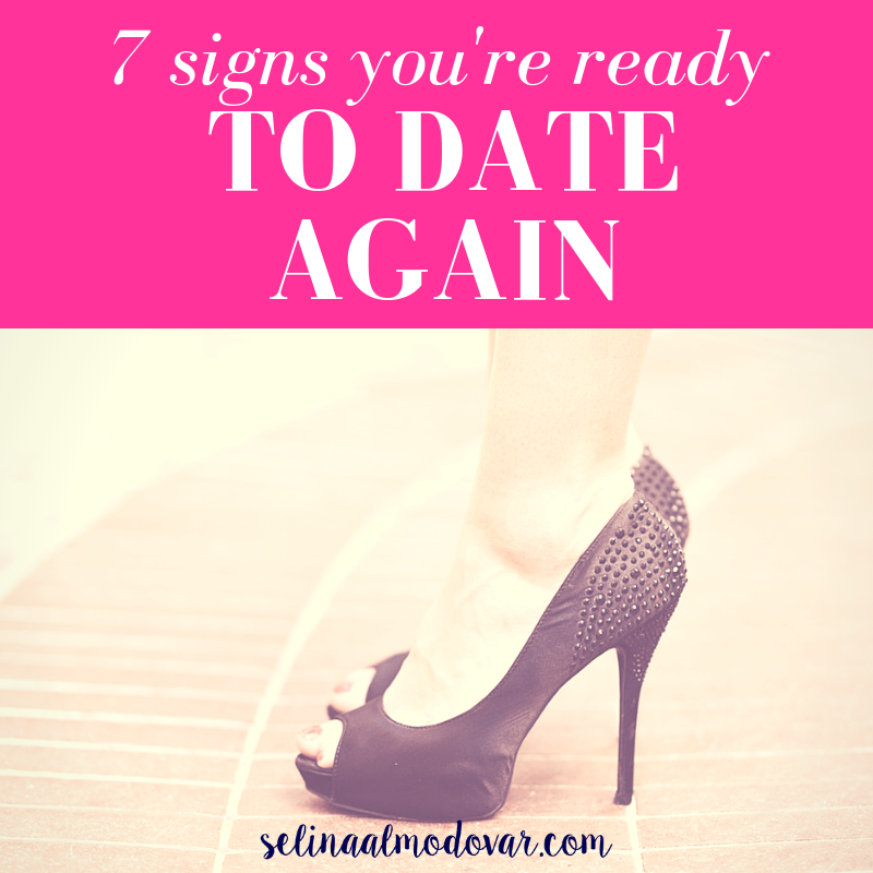"""woman wearing a pair of black peep-toe heels on a brick ground with pink overlay and white text that reads, """"7 Signs You're Ready to Date Again"""""""