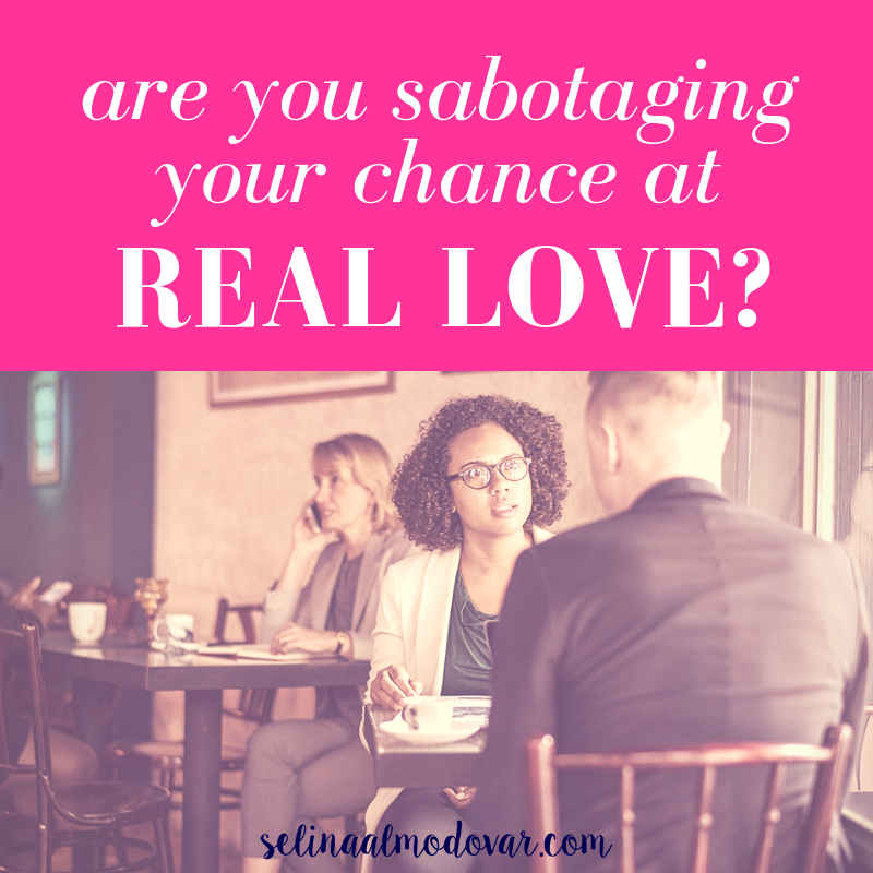 """girl looking serious at guy in a busy cafe with pink overlay and white text that reads, """"Are You Sabotaging Your Chance At Real Love?"""""""