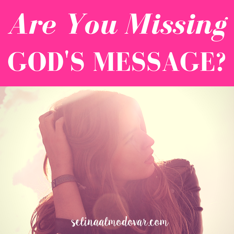 """girl looking to the side with her hand combing through her hair with pink overlay and white text that reads, """"Are You Missing God's Message?"""""""
