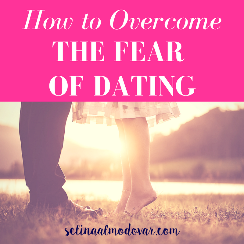 "How to OvercLegs and feet of guy and girl standing in the grass as they face each other with pink overlay and white text that reads, ""How to Overcome the Fear of Dating"""