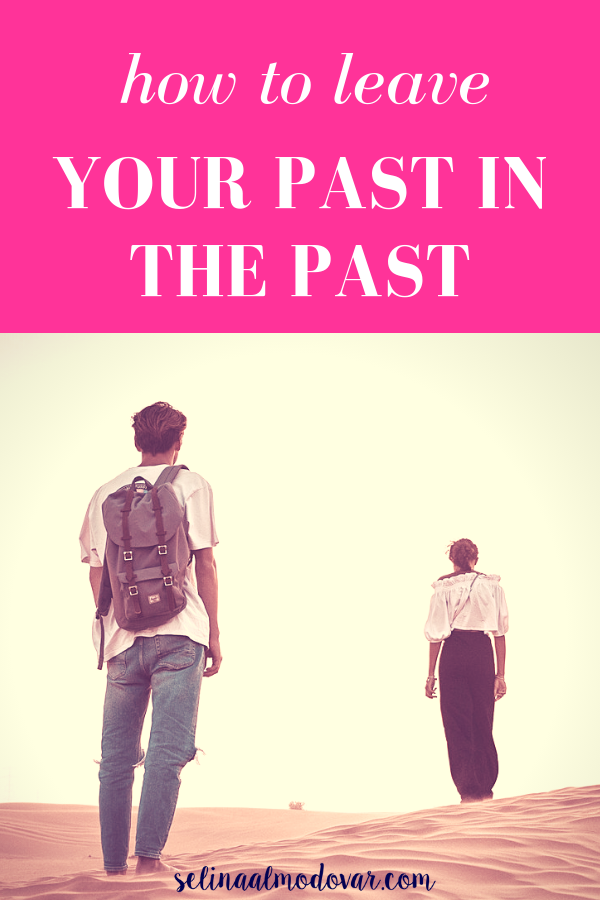 "guy standing in a desert wearing a backpack looking onward at a woman who is far ahead with pink overlay and white text that reads, ""How to Leave Your Past in the Past"""